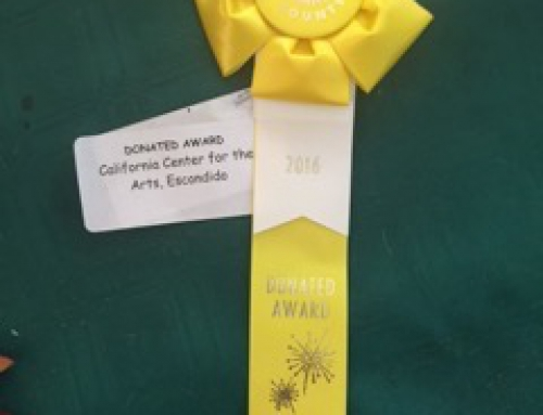 "July 4: Look What I won at the Del Mar Fair! It's a ribbon and award from the California   Center for the Arts in Escondido, CA for my large collage (hundreds of small acrylic  painted pieces) acrylic painting: ""Embraced in Wonderland."" SOLD."